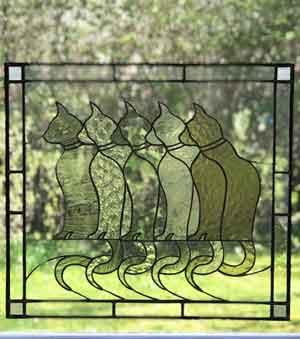 Tavla i glas med katter av Robin Fondin
